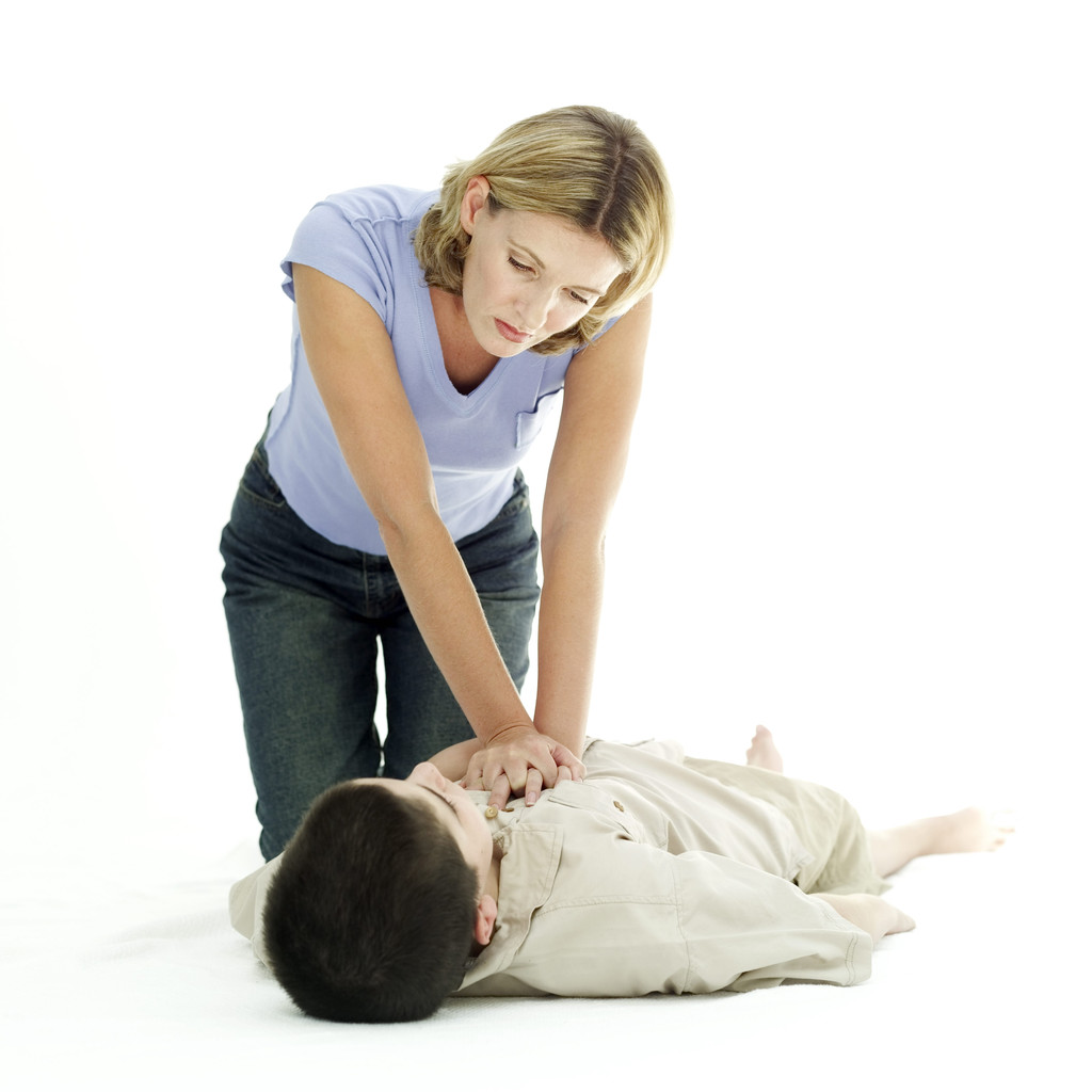 Woman Resuscitating a Young Boy
